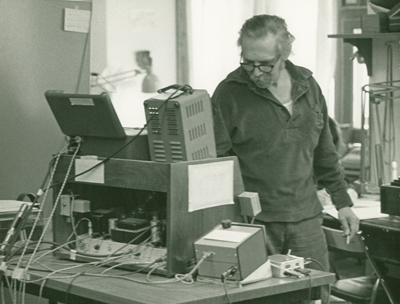 Edgar Villchur in his home lab, 1970s, working on the hearing aid prototype
